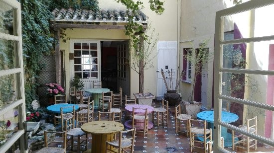 La Nena's patio, with its fountain (left), adorable tiles, and chairs